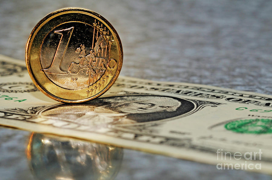 1-one-euro-coin-standing-up-on-us-dollar-banknote-sami-sarkis